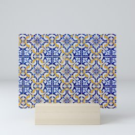 Close-up of blue, white and yellow ceramic wall tiles in Tavira, Portugal Mini Art Print