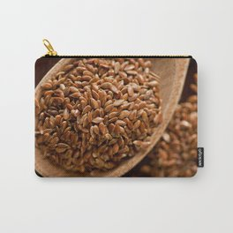 Brown flax seeds portion on wooden spoon Carry-All Pouch