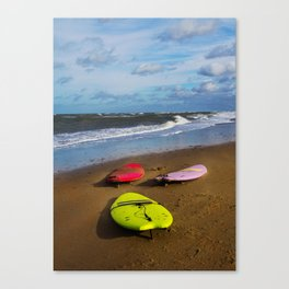 Surfing boards on beach Canvas Print