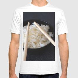Rice bowl with Chinese chopsticks on dark background T-shirt
