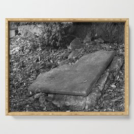 broken old grave on the green Serving Tray