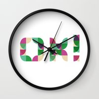 kim sy ok Wall Clocks featuring OK! by Manon Pntx