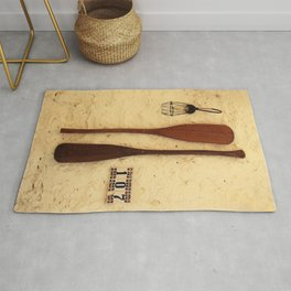 baker's peel on the wall Rug