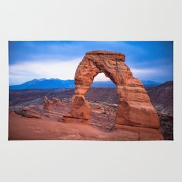 Delicate - Delicate Arch Glows on Rainy Day in Utah Desert Rug