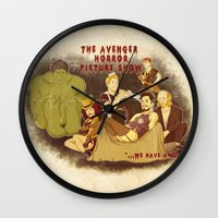 rocky horror picture show Wall Clocks featuring The Avenger Horror Picture Show by Leigh Lahav