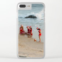 Christmas background. Happy girls in Santa Clause suit having fun on the beach. Clear iPhone Case
