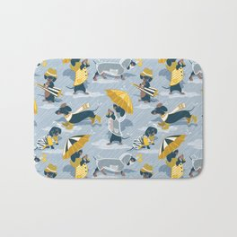 Ready For a Rainy Walk // pastel blue background dachshunds dogs with yellow and transparent rain co Bath Mat