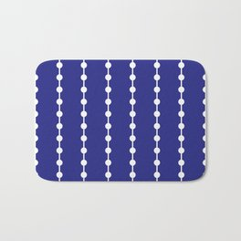 Geometric Droplets Pattern Linked White on Navy Blue Bath Mat