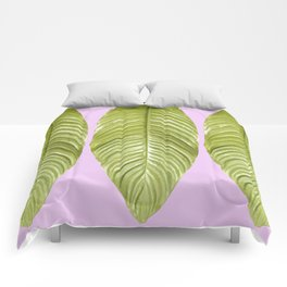 Three large green leaves on a pink background - vivid colors Comforters