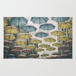Umbrellas in the sky Rug