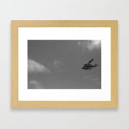 Plane in sky over Seattle Framed Art Print