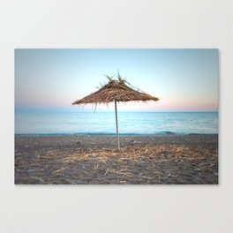 Straw umbrellas on the beach Canvas Print
