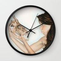 animal skull Wall Clocks featuring Confrontation, animal skull and human by Alexandra Bastien