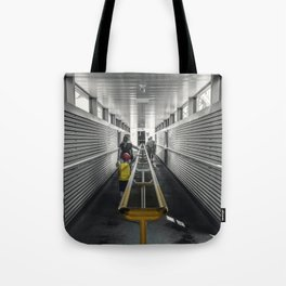 kid in yellow Tote Bag