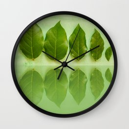 Five leaves with reflections in water close front view Wall Clock