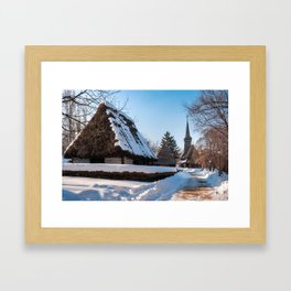 Picturesque street covered in snow at the Village Museum in Bucharest Framed Art Print
