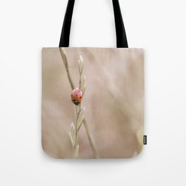 Ladybug in the grass Tote Bag