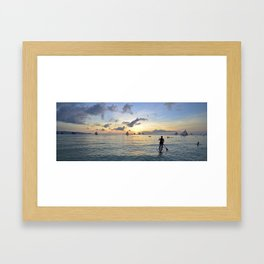 Paddle boarding into the sunset.  Framed Art Print
