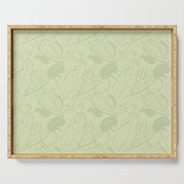 Cucumbers, kiwi, apples, limes and greens on a light green background. Serving Tray