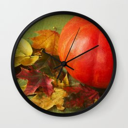 big pumpkin and colorful autumn leaves on a green wooden background horizontal Wall Clock
