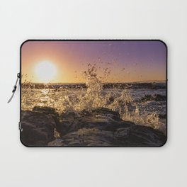 Magical sunset and waves breaking over rocky beach Laptop Sleeve