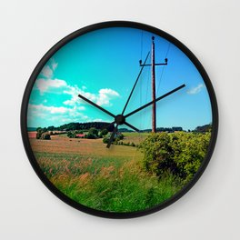 Clouds, a powerline and lots of green Wall Clock