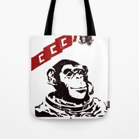 soviet Tote Bags featuring Soviet Space Monkey by Chris Kawagiwa