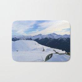 The snowy rocks at mountain tops Bath Mat