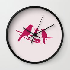 Girl tells a story to her friends Wall Clock