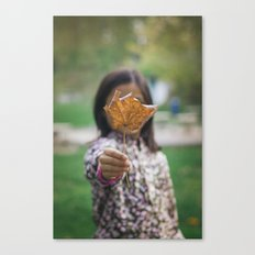 Girl holding leaf Canvas Print