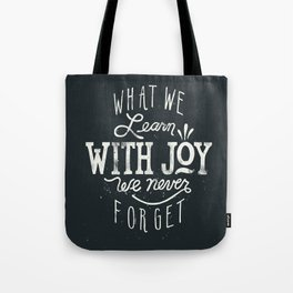 What We Learn With Joy - We Never Forget Tote Bag