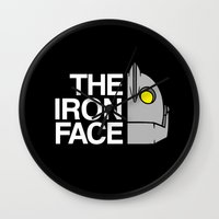 iron giant Wall Clocks featuring The Iron Face by Buby87