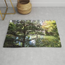 Peaceful Pond in Japanese Garden with Trees and a Bridge Rug