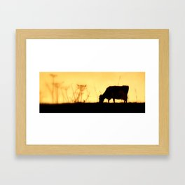 Cow up yonder. Framed Art Print