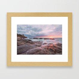 Rocky beach at sunset Framed Art Print