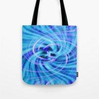 pivot Tote Bags featuring Blue twirl by AvHeertum