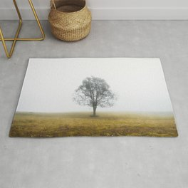 Lonely tree in a foggy autumn morning Rug