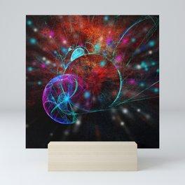 Ammonite emerging from space Mini Art Print