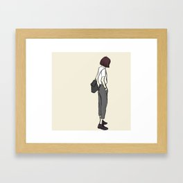 Girl standing while wearing a backpack and looking so cool Framed Art Print