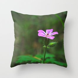 Photo of a pink flower on a green blurred background Throw Pillow