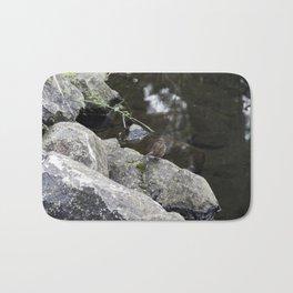 Sparrow on a rock Bath Mat