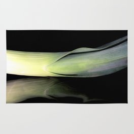Leek on Black Rug