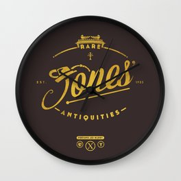 """Jones' Rare Antiquities"" - gold version Wall Clock"