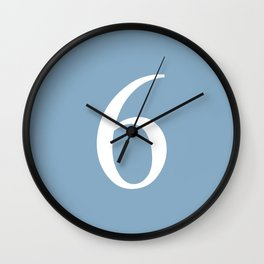 number six sign on placid blue color background Wall Clock