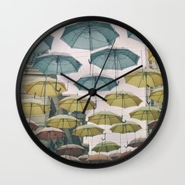Umbrellas in the sky Wall Clock