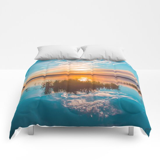 River sunset Comforters