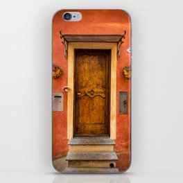 Wooden door of Tuscany with typical bright colors on its walls. Next to two small pots with flowers iPhone Skin