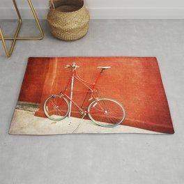 Red Tall Bike Against Brick Wall Rug
