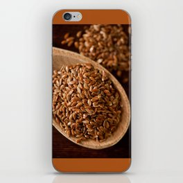 Brown flax seeds portion on wooden spoon iPhone Skin
