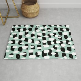 Spotted series abstract dashes mint black and white raw paint spots Rug